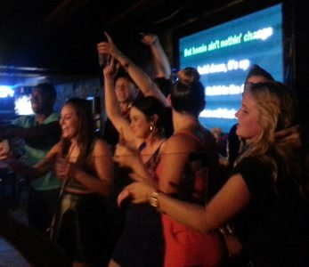 ladies singing karaoke